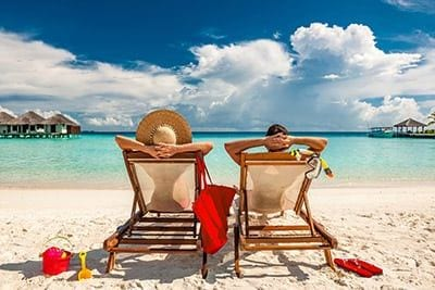 Couple Lounging At Beach