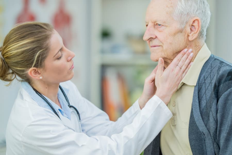 Doctor Examining Lymph Nodes