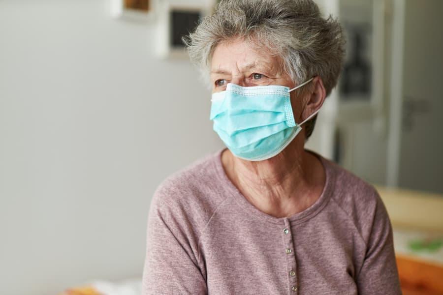 Older woman wearing face mask
