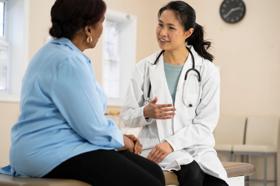 Doctor talks with senior patient