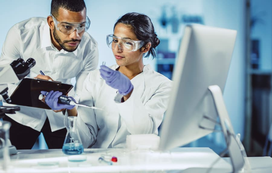 Scientists performing lab analysis
